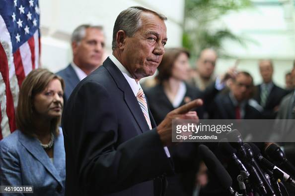 Speaker of the House John Boehner talks with reporters after the weekly House Republican caucus meeting at the US Capitol July 9 2014 in Washington...