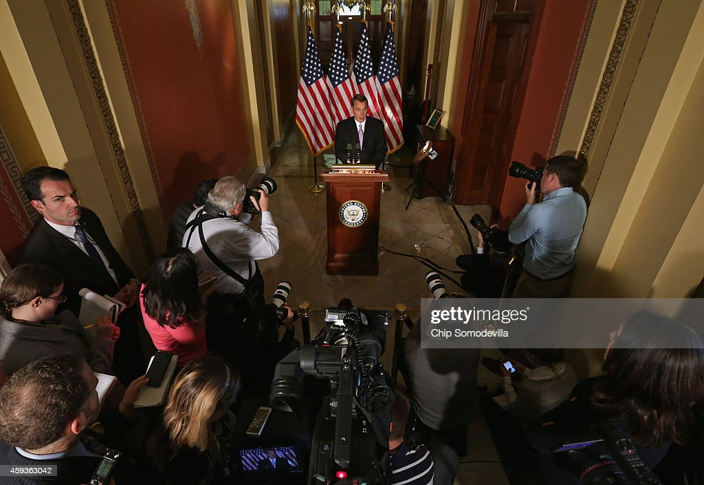 Speaker of the House John Boehner talks with reporters in his office in the US Capitol November 21 2014 in Washington DC Boehner was critical of US...