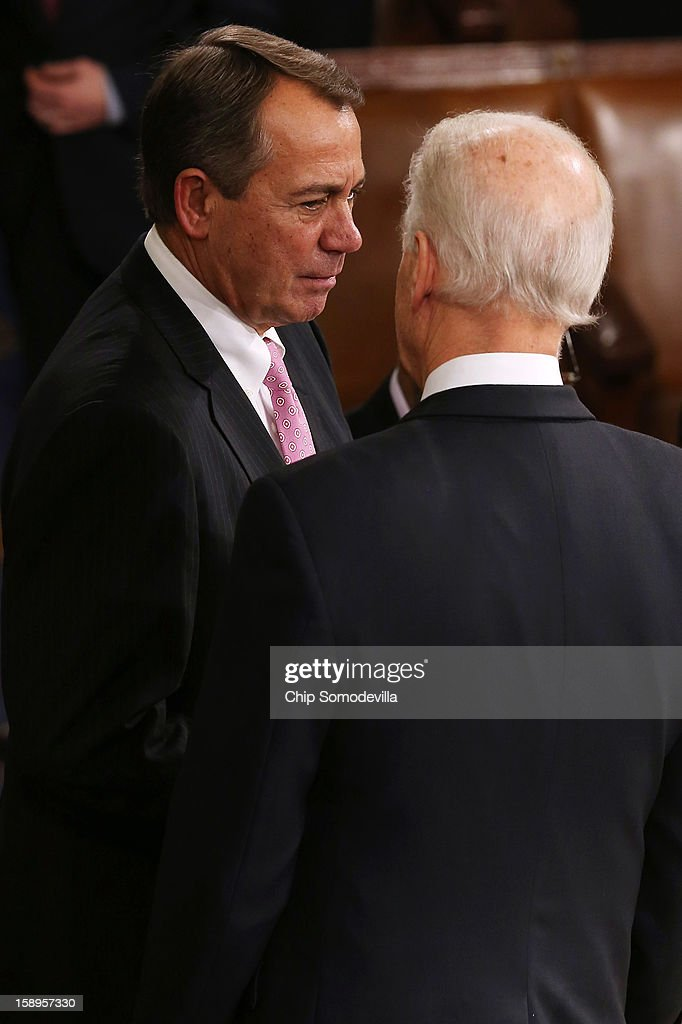 Speaker of the House <a gi-track='captionPersonalityLinkClicked' href=/galleries/search?phrase=John+Boehner&family=editorial&specificpeople=274752 ng-click='$event.stopPropagation()'>John Boehner</a> (R-OH) talks with Vice President Joe Biden after the Electorial College votes from the 50 states were tallied in the House of Representatives chamber at the U.S. Capitol January 4, 2013 in Washington, DC. The votes were tallied during a joint session of the 113th Congress. President Barack Obama and Biden received 332 votes to be reelected.