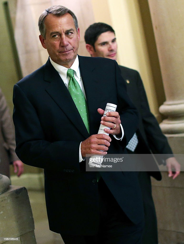 Speaker of the House <a gi-track='captionPersonalityLinkClicked' href=/galleries/search?phrase=John+Boehner&family=editorial&specificpeople=274752 ng-click='$event.stopPropagation()'>John Boehner</a> (R-OH) walks to the House chamber to speak on the pending 'fiscal cliff' negotiations December 11, 2012 in Washington, DC. Congress and U.S. President Barack Obama's White House remain locked in a stalemate over the negotiations seeking a settlement to the fiscal crisis.