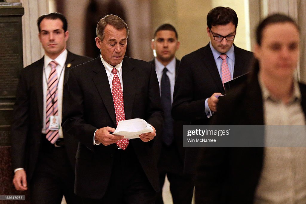 S Speaker of the House John Boehner walks to the House Chamber to vote on the recently announced bipartisan budget agreement December 12 2013 in...