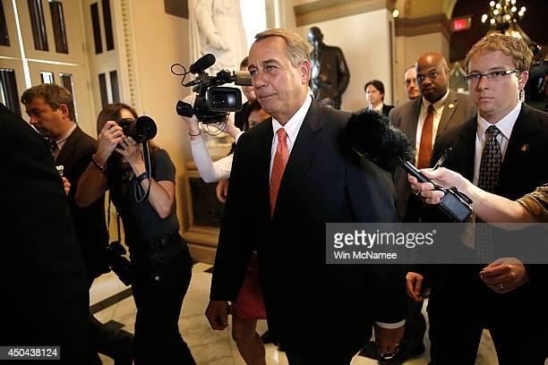 S Speaker of the House John Boehner walks to the House chamber trailed by reporters June 11 2014 in Washington DC Yesterday House Majority Leader...