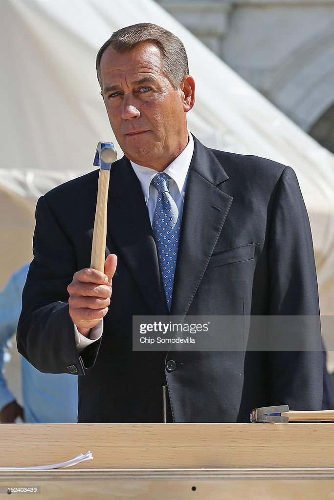 Speaker of the House <a gi-track='captionPersonalityLinkClicked' href=/galleries/search?phrase=John+Boehner&family=editorial&specificpeople=274752 ng-click='$event.stopPropagation()'>John Boehner</a> (R-OH) wields a hammer before the 'First Nail' ceremony, signifying the start of construction of the 2013 Inaugural Platform on the West Front of the U.S. Capitol September 20, 2012 in Washington, DC. Sen. Lamar Alexander (R-TN) is at center. The winner of the November 6 presidential election will be sworn in on the platform on January 21, 2013.