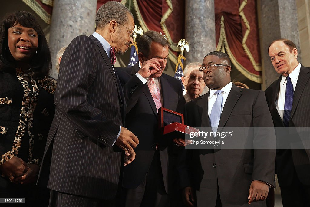 Speaker of the House John Boehner (R-OH) (C) wipes away a tear while presenting the Congressional Gold Medal to Dr. Lawrence Pijeaux (2nd L) of the Birmingham Civil Rights Institute and Rev. Arthur Price (2nd R) of the 16th Street Baptist Church during a ceremony with Rep. Terri Sewell (D-AL) (L) and Sen. Richard Shelby (R-AL) September 10, 2013 in Washington, DC. Pijeaux accepted the medal on behalf of Addie Mae Collins, Denise McNair, Carole Robertson, and Cynthia Wesley, victims of the 1963 16th Street Baptist Church bombing in Birmingham, Alabama. The medal honors the girls' sacrifice and how it served as a catalyst for the Civil Rights Movement.