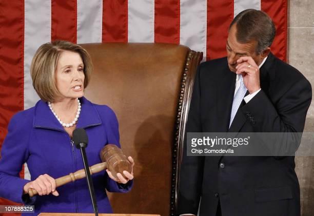 Speaker of the House John Boehner wipes his eyes as outgoing Speaker of the House Nancy Pelosi prepares to hand over over the Speaker's gavel...