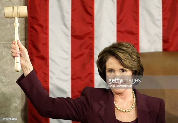 Speaker of the House Nancy Pelosi holds up the Speaker's gavel after being elected as the first woman Speaker during a swearing in ceremony for the...