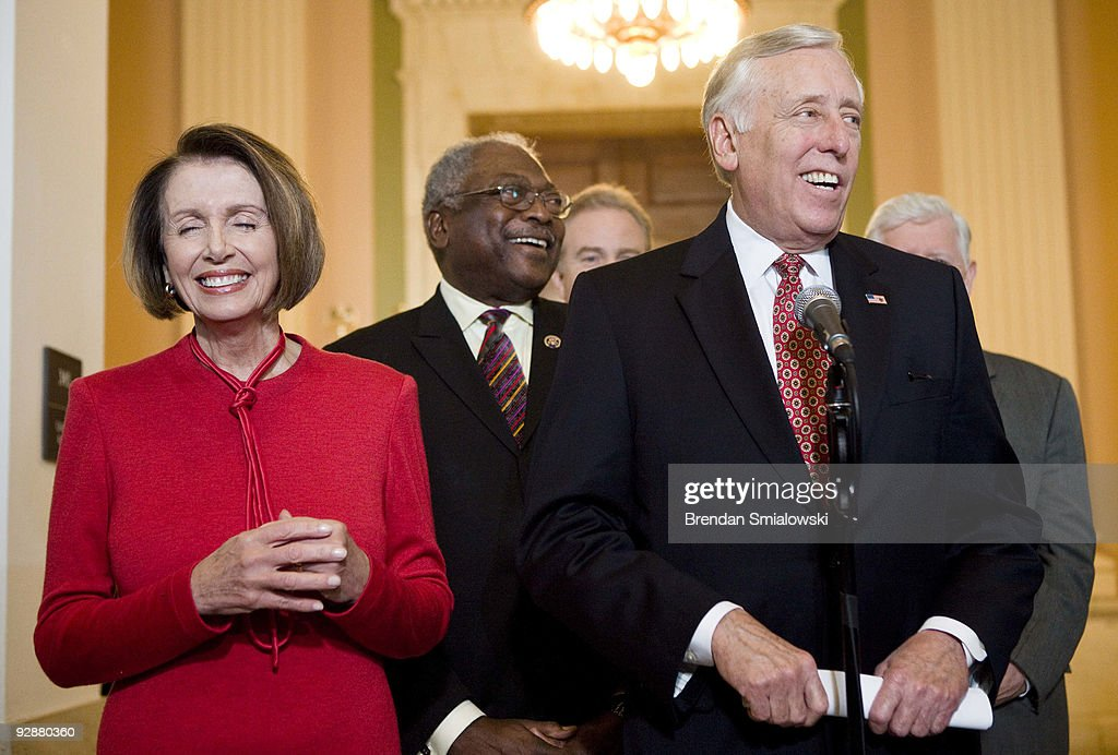 Speaker of the House Nancy Pelosi (D-CA) (L), House Majority Whip James Clyburn (D-SC) (C) and House Majority Leader Steny Hoyer (D-MD) (R) laugh while speaking to the press after a caucus meeting with President Barack Obama on Capitol Hill November 7, 2009 in Washington, DC. US President Barack Obama spoke with members of the House Democratic Caucus about healthcare reform legislation which is expected to be voted on today.
