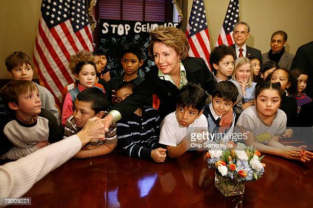 Speaker of the House Nancy Pelosi shakes hands with parents and teachers during a photo oportunity with students from Oyster Bilingual School in her...