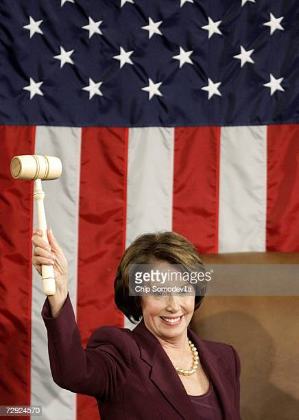 Speaker of the House Nancy Pelosi wields the Speaker's gavel after being elected as the first woman Speaker during a swearing in ceremony for the...