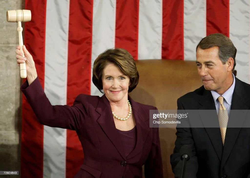Speaker of the House Nancy Pelosi (D-CA) wields the Speaker's gavel after being elected as the first woman Speaker during a swearing in ceremony for the 110th Congress in the House Chamber of the U.S. Capitol January 4, 2007 in Washington, DC. At right is Rep. John Boehner (R- OH), House Minority Leader who presented the gavel to Pelosi.