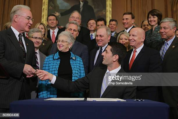 Speaker of the House Paul Ryan hands the pen he signed legislation to repeal the Affordable Care Act also known as Obamacare and to cut off federal...