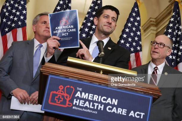 Speaker of the House Paul Ryan holds up a copy of the American Health Care Act during a news conference with House Majority Leader Kevin McCarthy and...