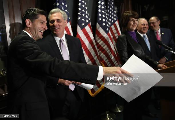 S Speaker of the House Paul Ryan jokes with House Majority Leader Kevin McCarthy during a press conference following a meeting of the House...