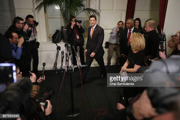 Speaker of the House Paul Ryan leaves a meeting of the House Republican caucus meeting at the US Capitol March 23 2017 in Washington DC Ryan and...