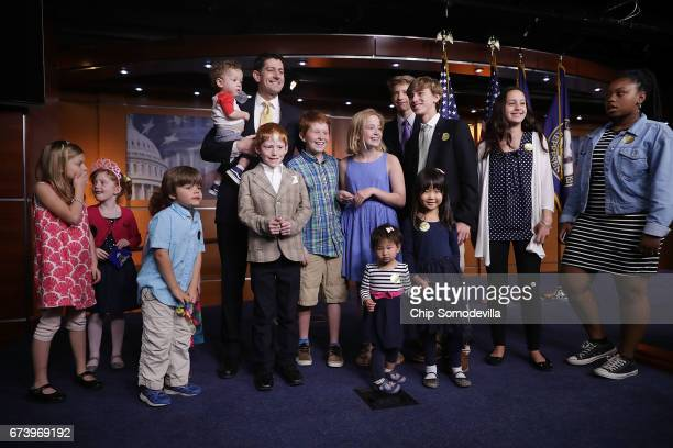 Speaker of the House Paul Ryan poses for photographs with journalists' children at the conclusion of his news conference at the US Capitol Visitors...