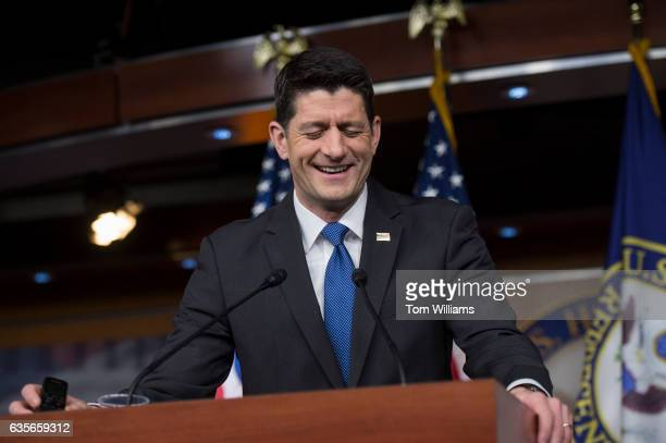 Speaker of the House Paul Ryan RWis reacts after dropping a recorder during his weekly news conference while making a point about the House...