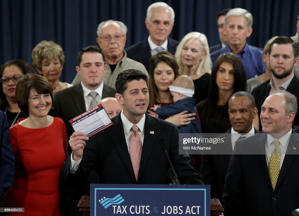 Speaker of the House Paul Ryan (R-WI), surrounded by American families, and members of the House Republican leadership introduces tax reform legislation November 2, 2017 in Washington, DC. The tax reform legislation is a centerpiece of U.S. President Donald Trump's legislative agenda.