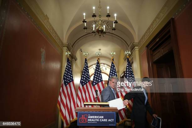 Speaker of the House Paul Ryan takes his notes after talking to reporters about the American Health Care Act with House Majority Leader Kevin...