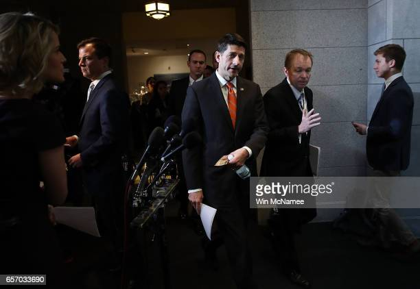 S Speaker of the House Paul Ryan walks with OMB Director Mick Mulvaney to a meeting of the House Republican caucus at the US Capitol March 23 2017 in...