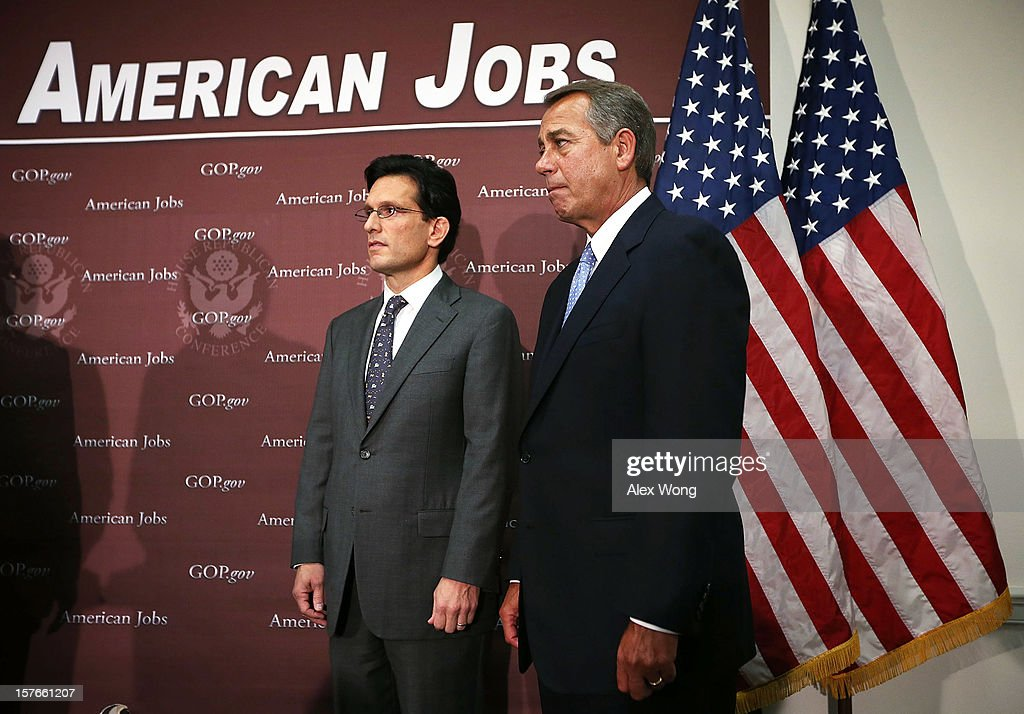 S Speaker of the House Rep John Boehner and House Majority Leader Rep Eric Cantor listen during a news conference after a House Republican conference...