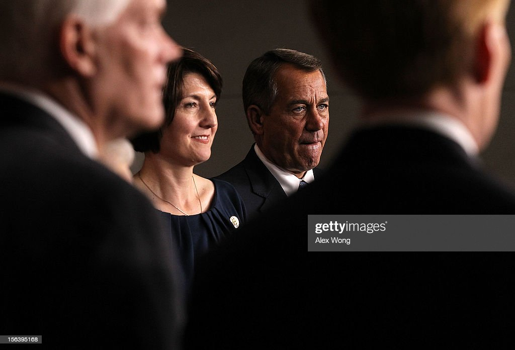 U.S. Speaker of the House Rep. <a gi-track='captionPersonalityLinkClicked' href=/galleries/search?phrase=John+Boehner&family=editorial&specificpeople=274752 ng-click='$event.stopPropagation()'>John Boehner</a> (R-OH) (R) as Rep. Cathy McMorris Rodgers (R-WA) (L) listen during a news conference to introduce the House Republican leadership for the next Congress November 14, 2012 on Capitol Hill in Washington, DC. The House Republicans have picked their choices of leadership for the 113th Congress.