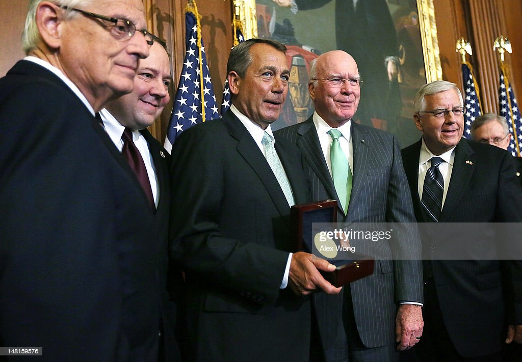 U.S. Speaker of the House Rep. <a gi-track='captionPersonalityLinkClicked' href=/galleries/search?phrase=John+Boehner&family=editorial&specificpeople=274752 ng-click='$event.stopPropagation()'>John Boehner</a> (R-OH) (3rd L) holds the Congressional Gold Medal as he pose for photos with (L-R) Rep. Bill Pascrell (D-NJ), Rep. Pat Tiberi (R-OH), Sen. Patrick Leahy (D-VT), and Sen. Michael Enzi (R-WY) during a ceremony to award the Congressional Gold Medal posthumously to Constantino Brumidi July 11, 2012 on Capitol Hill in Washington, DC. Brumidi was awarded with the medal for his many artistic contributions to the United States Capitol.