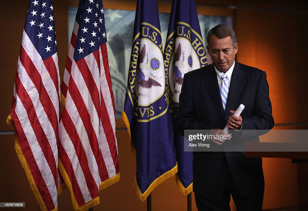 U.S. Speaker of the House Rep. <a gi-track='captionPersonalityLinkClicked' href=/galleries/search?phrase=John+Boehner&family=editorial&specificpeople=274752 ng-click='$event.stopPropagation()'>John Boehner</a> (R-OH) leaves after a press briefing July 31, 2014 on Capitol Hill in Washington, DC. Boehner held his weekly news briefing to discuss Republican agenda.