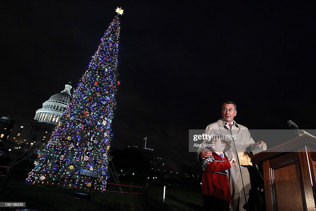 U.S. Speaker of the House Rep. <a gi-track='captionPersonalityLinkClicked' href=/galleries/search?phrase=John+Boehner&family=editorial&specificpeople=274752 ng-click='$event.stopPropagation()'>John Boehner</a> (R-OH) (R) lights up the 2011 Capitol Christmas Tree with Seven-year-old Johnny Crawford (L) of Sonora, California, at the West Front of the Capitol December 6, 2011 on Capitol Hill in Washington, DC. This year's tree was a 65-foot tall Sierra white fir from the Stanislaus National Forest in California.