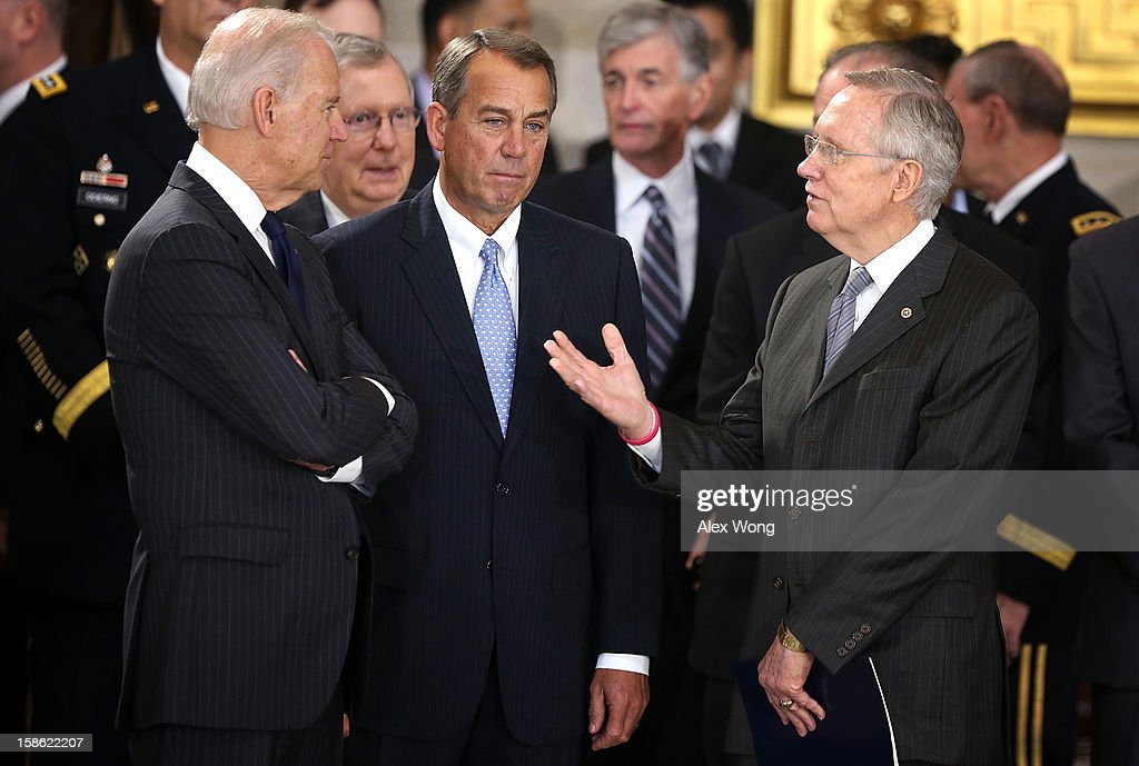 U.S. Speaker of the House Rep. John Boehner (R-OH) (2nd R) listens to Senate Majority Leader Sen. <a gi-track='captionPersonalityLinkClicked' href=/galleries/search?phrase=Harry+Reid&family=editorial&specificpeople=203136 ng-click='$event.stopPropagation()'>Harry Reid</a> (D-NV) (R) as Senate Minority Leader Sen. Mitch McConnell (R-KY) (2nd L) and Vice President <a gi-track='captionPersonalityLinkClicked' href=/galleries/search?phrase=Joseph+Biden&family=editorial&specificpeople=206897 ng-click='$event.stopPropagation()'>Joseph Biden</a> look on as Sen. Daniel Inouye (D-HI) lies in state in the Rotunda of the U.S. Capitol during a service December 20, 2012 on Capitol Hill in Washington, DC. A public funeral service will be held at the Washington National Cathedral tomorrow for Senator Inouye, a World War II veteran and the second-longest serving senator in history, who died at the age of 88 on December 17 at Walter Reed National Military Medical Center in Bethesda, Maryland, where he had been hospitalized since early December. His remains will be returned and laid to rest in his home state.