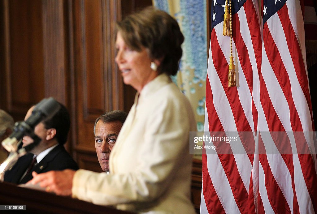 U.S. Speaker of the House Rep. <a gi-track='captionPersonalityLinkClicked' href=/galleries/search?phrase=John+Boehner&family=editorial&specificpeople=274752 ng-click='$event.stopPropagation()'>John Boehner</a> (R-OH) (L) looks on as House Minority Leader Rep. <a gi-track='captionPersonalityLinkClicked' href=/galleries/search?phrase=Nancy+Pelosi&family=editorial&specificpeople=169883 ng-click='$event.stopPropagation()'>Nancy Pelosi</a> (D-CA) (R) speaks during a ceremony to award the Congressional Gold Medal posthumously to Constantino Brumidi July 11, 2012 on Capitol Hill in Washington, DC. Brumidi was awarded with the medal for his many artistic contributions to the United States Capitol.