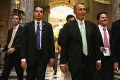 S Speaker of the House Rep John Boehner on his way back to his office after a vote on the floor August 1 2014 on Capitol Hill in Washington DC The...