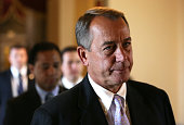S Speaker of the House Rep John Boehner on his way to the House Chamber for a procedural vote on the House floor September 28 2013 on Capitol Hill in...