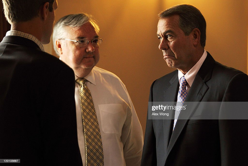 U.S. Speaker of the House Rep. <a gi-track='captionPersonalityLinkClicked' href=/galleries/search?phrase=John+Boehner&family=editorial&specificpeople=274752 ng-click='$event.stopPropagation()'>John Boehner</a> (R-OH) (R) pauses as he listens to his chief of staff Barry Jackson (2nd L) and policy director Brett Loper (L) at the Statuary Hall of the Capitol July 30, 2011 in Washington, DC. The House was set to vote on Senate Majority Leader Harry Reid's measure of the Budget Control Act.
