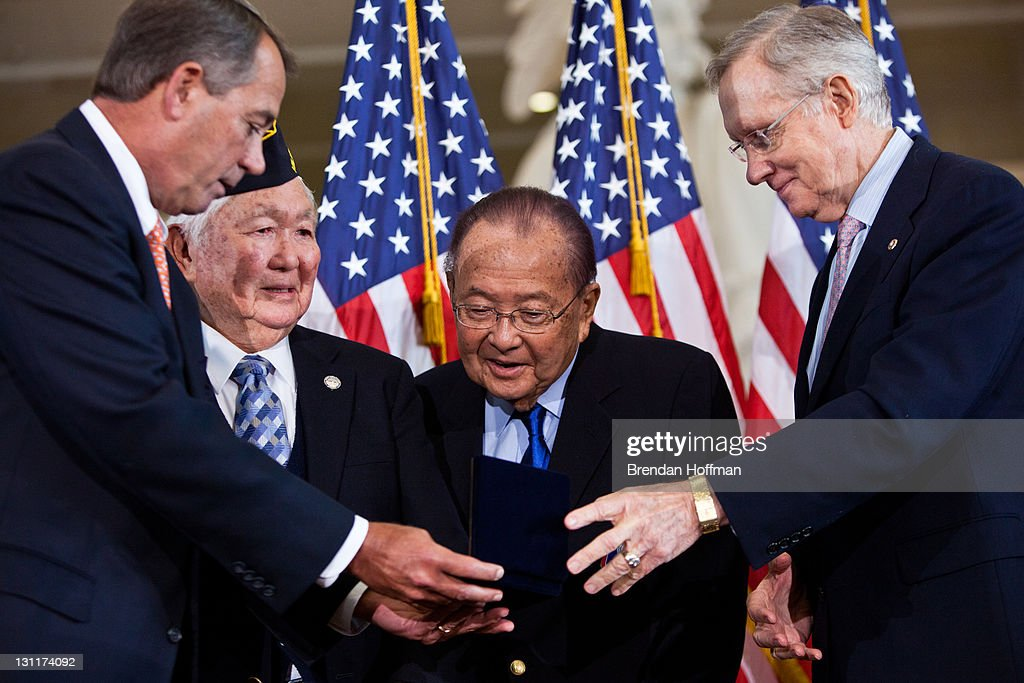 Speaker of the House Rep. John Boehner (R-OH) (L) presents the Congressional Gold Medal to Grant Ichikawa (2nd L), representing the Military Intelligence Service and Japanese-American veterans in recognition of dedicated service during World War II, as Sen. Daniel Inouye (D-HI) (2nd R) and Senate Majority Leader Sen. Harry Reid (D-NV) look on on November 2, 2011 in Washington, DC. About 19,000 veterans were awarded the honor, which is Congress' highest civilian medal.