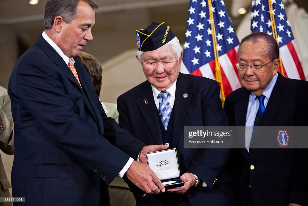 Speaker of the House Rep. John Boehner (R-OH) (L) presents the Congressional Gold Medal to Grant Ichikawa (C), representing the Military Intelligence Service and Japanese-American veterans, in recognition of dedicated service during World War II, as Sen. Daniel Inouye (D-HI) watches on November 2, 2011 in Washington, DC. About 19,000 veterans were awarded the honor, which is Congress' highest civilian medal.