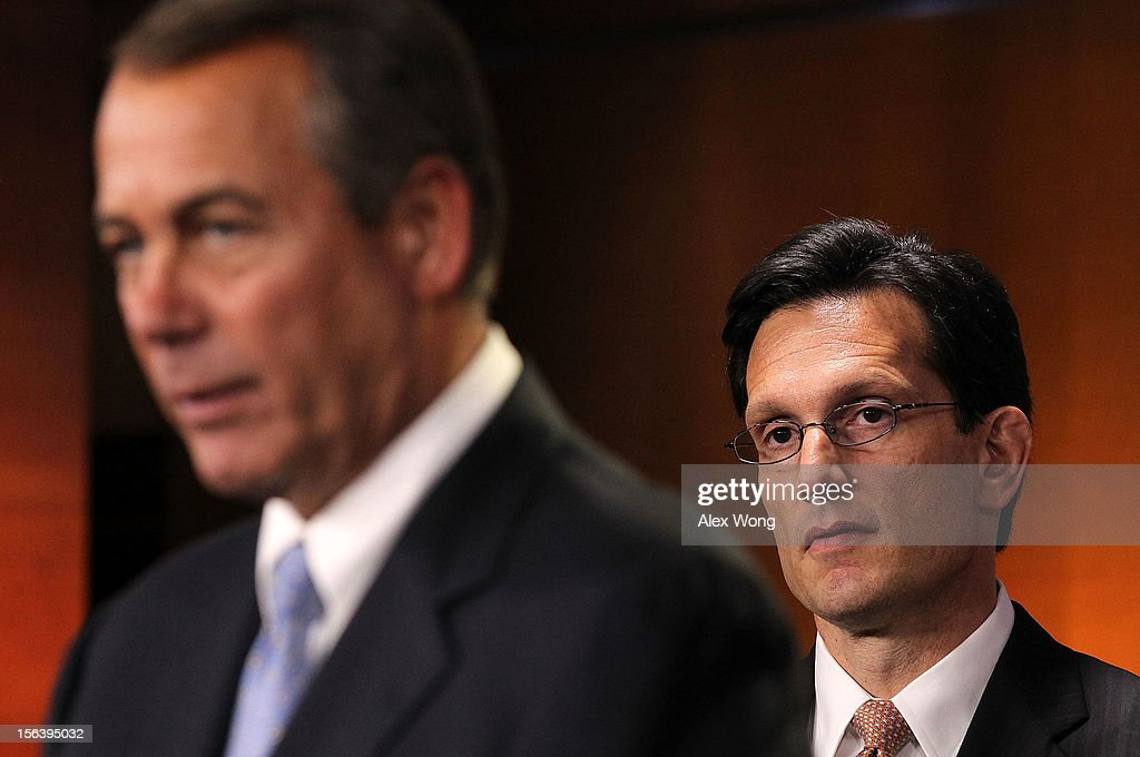 U.S. Speaker of the House Rep. John Boehner (R-OH) (L) speaks as House Majority Leader Rep. <a gi-track='captionPersonalityLinkClicked' href=/galleries/search?phrase=Eric+Cantor&family=editorial&specificpeople=653711 ng-click='$event.stopPropagation()'>Eric Cantor</a> (R-VA) (R) looks on during a news conference November 14, 2012 on Capitol Hill in Washington, DC. The House Republicans have picked their choices of leadership for the 113th Congress.