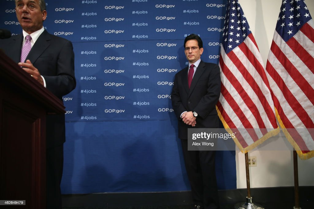 S Speaker of the House Rep John Boehner speaks as House Majority Leader Rep Eric Cantor listens during a news briefing after a House Republican...