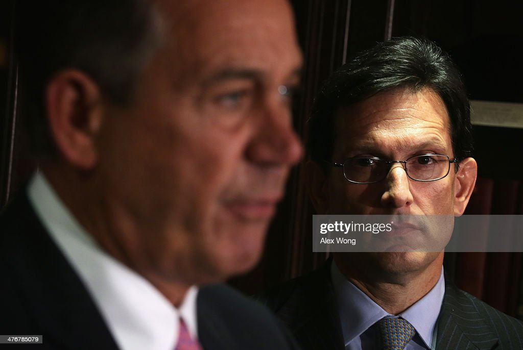 U.S. Speaker of the House Rep. John Boehner (R-OH) (L) speaks as House Majority Leader Rep. <a gi-track='captionPersonalityLinkClicked' href=/galleries/search?phrase=Eric+Cantor&family=editorial&specificpeople=653711 ng-click='$event.stopPropagation()'>Eric Cantor</a> (R-VA) (R) looks on during a briefing March 5, 2014 at the headquarters of the Republican National Committee in Washington, DC. House Republicans briefed members of the media after a closed conference meeting.