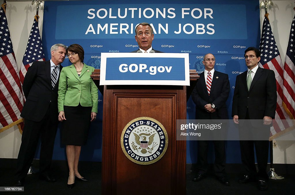 S Speaker of the House Rep John Boehner speaks as House Majority Whip Rep Kevin McCarthy Rep Cathy McMorris Rodgers Rep Charles Boustany and House...