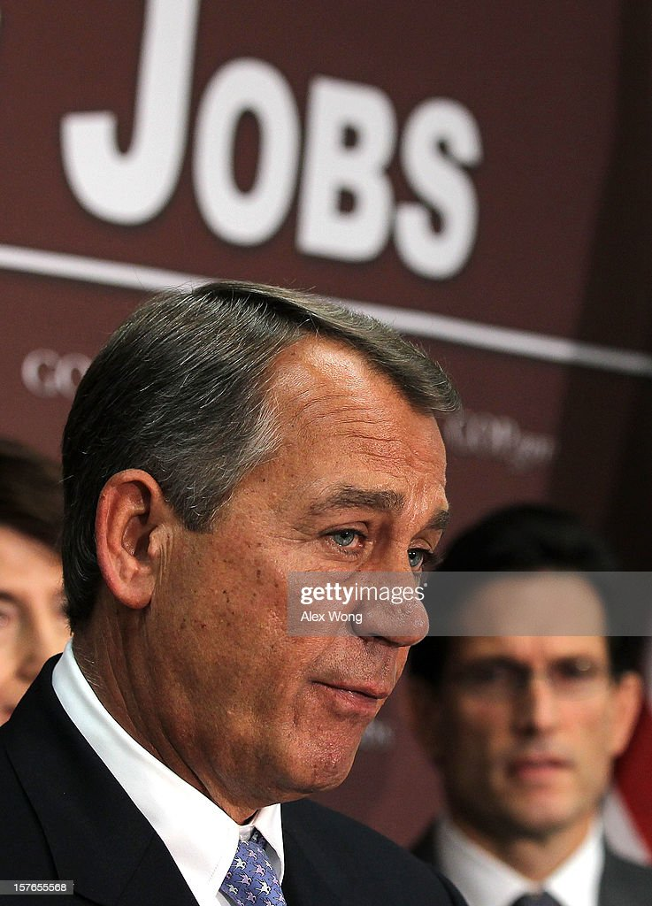 U.S. Speaker of the House Rep. John Boehner (R-OH) (L) speaks House Majority Leader Rep. <a gi-track='captionPersonalityLinkClicked' href=/galleries/search?phrase=Eric+Cantor&family=editorial&specificpeople=653711 ng-click='$event.stopPropagation()'>Eric Cantor</a> (R-VA) (R) listens during a news conference after a House Republican conference meeting December 5, 2012 on Capitol Hill in Washington, DC. The House Republican leadership held a news conference to discuss its negotiations with the White House on the fiscal cliff issue.