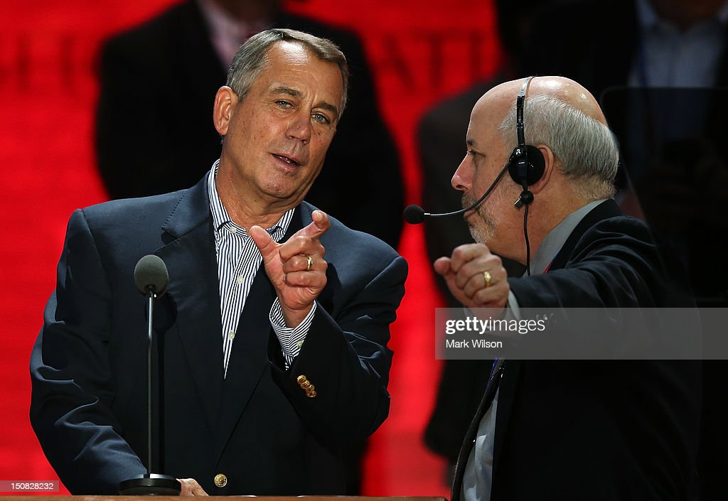 U.S. Speaker of the House Rep. <a gi-track='captionPersonalityLinkClicked' href=/galleries/search?phrase=John+Boehner&family=editorial&specificpeople=274752 ng-click='$event.stopPropagation()'>John Boehner</a> (R-OH) (L) stands at the podium with stage manager Howard Kolins on the abbreviated first day of the Republican National Convention at the Tampa Bay Times Forum on August 27, 2012 in Tampa, Florida. The RNC is scheduled to convene today, but will hold its first full session tomorrow after being delayed due to Tropical Storm Isaac.
