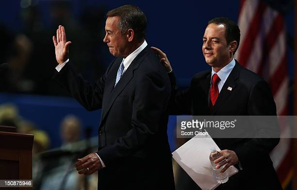 S Speaker of the House Rep John Boehner stands on stage with RNC Chairman Reince Priebus during the Republican National Convention at the Tampa Bay...
