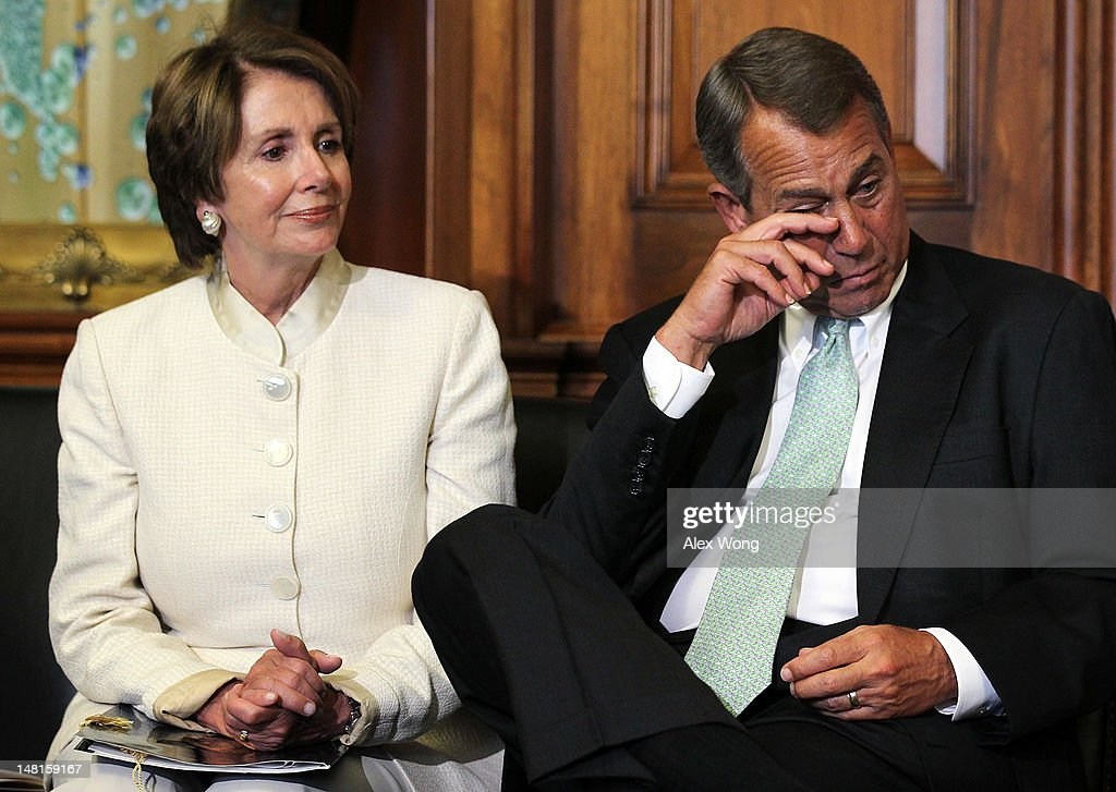 U.S. Speaker of the House Rep. John Boehner (R-OH) (R) wipes tear as House Minority Leader Rep. Nancy Pelosi (D-CA) (L) looks on during a ceremony to award the Congressional Gold Medal posthumously to Constantino Brumidi July 11, 2012 on Capitol Hill in Washington, DC. Brumidi was awarded with the medal for his many artistic contributions to the United States Capitol.