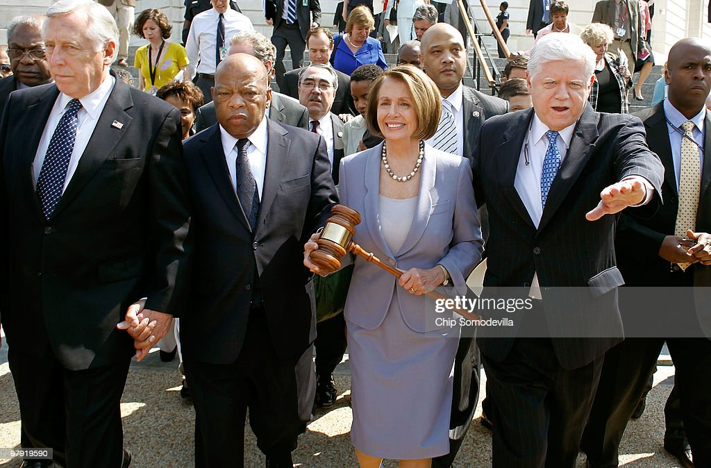 Speaker of the House Rep. Nancy Pelosi (D-CA) (C) carries the gavel that was used when Medicare was passed by the House in the 1960s while marching with (L-R) Majority Leader Rep. Steny Hoyer (D-MD), Rep. John Lewis (D-GA), Rep. John Larson (D-CT) and other members of the Democratic Caucus from the Cannon House Office Building to the U.S. Capitol for the health care reform vote March 21, 2010 in Washington, DC. Hoyer said he was confident that the Democrats have the necessary 216 votes to pass landmark health care reform legislation today.
