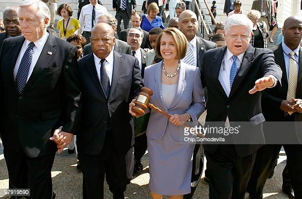 Speaker of the House Rep Nancy Pelosi carries the gavel that was used when Medicare was passed by the House in the 1960s while marching with Majority...