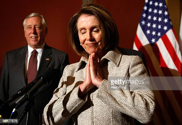 S Speaker of the House Rep Nancy Pelosi gestures as she speaks to the media as House Majority Leader Rep Steny Hoyer listens during a press...