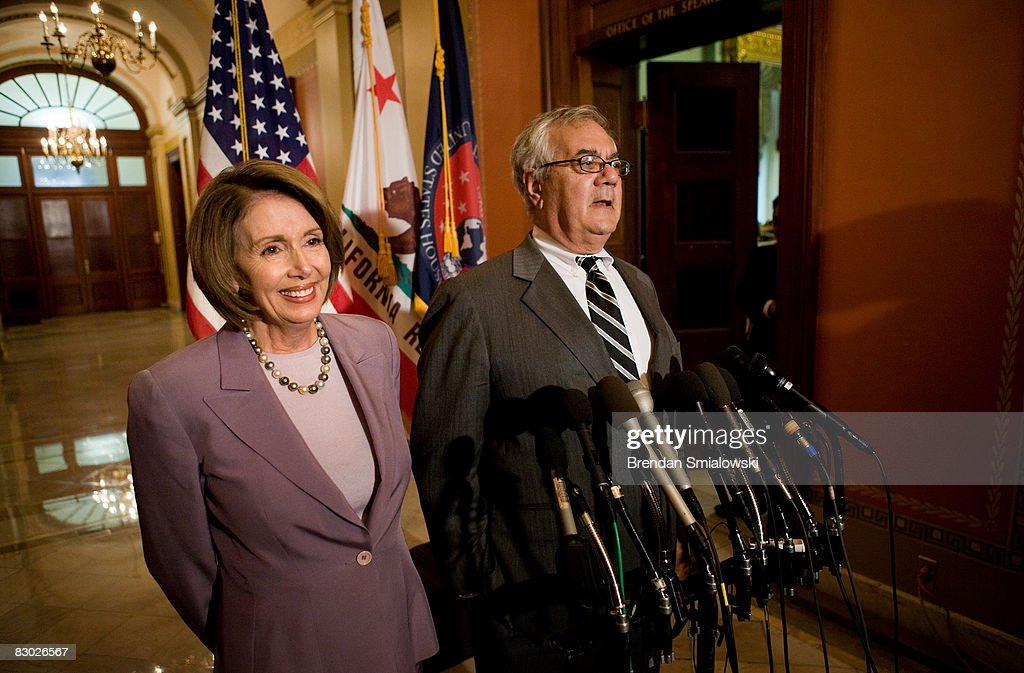 Speaker of the House Sen Nancy Pelosi listens to House Financial Services Committee chairman Sen Barney Frank speak during a news conference on...