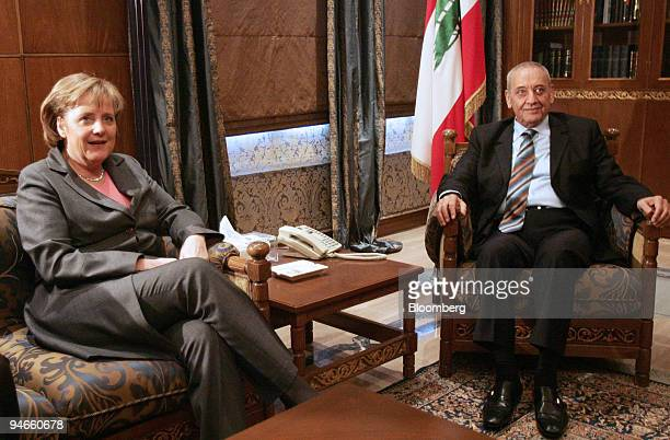 Speaker of the Lebanese Parliament Nabih Berri right poses with German Chancellor Angela Merkel in Beirut Lebanon Monday April 2 2007 Merkel urged...