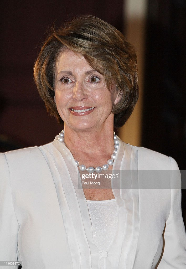Speaker of the U.S. House of Representatives <a gi-track='captionPersonalityLinkClicked' href=/galleries/search?phrase=Nancy+Pelosi&family=editorial&specificpeople=169883 ng-click='$event.stopPropagation()'>Nancy Pelosi</a> arrives at the NIAF 32nd Anniversary Awards Gala at the Hilton Washington & Towers on October 13, 2007, in Washington, DC.