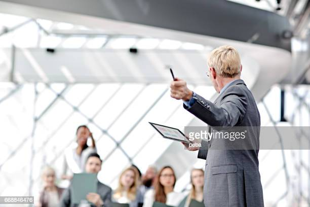 Speaker presenting at business seminar